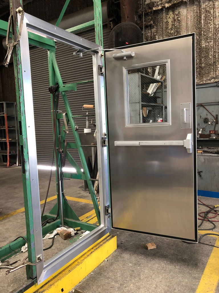 """3'-2"""" x 6'-10"""" Aluminum Container Door w/ 4-Sided Frame, 18"""" x 24"""" Window, panic, and closer"""